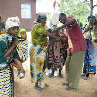 Pastor Masunga helps out with weighing babies