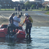A crew member takes the owners details at Baiter slipway after a broken down speedboat had been towed from Poole Lifeboat Station 12 June 2014 Photo: RNLI Poole