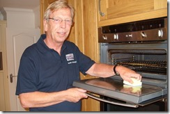 Mark Bedford cleaning an oven
