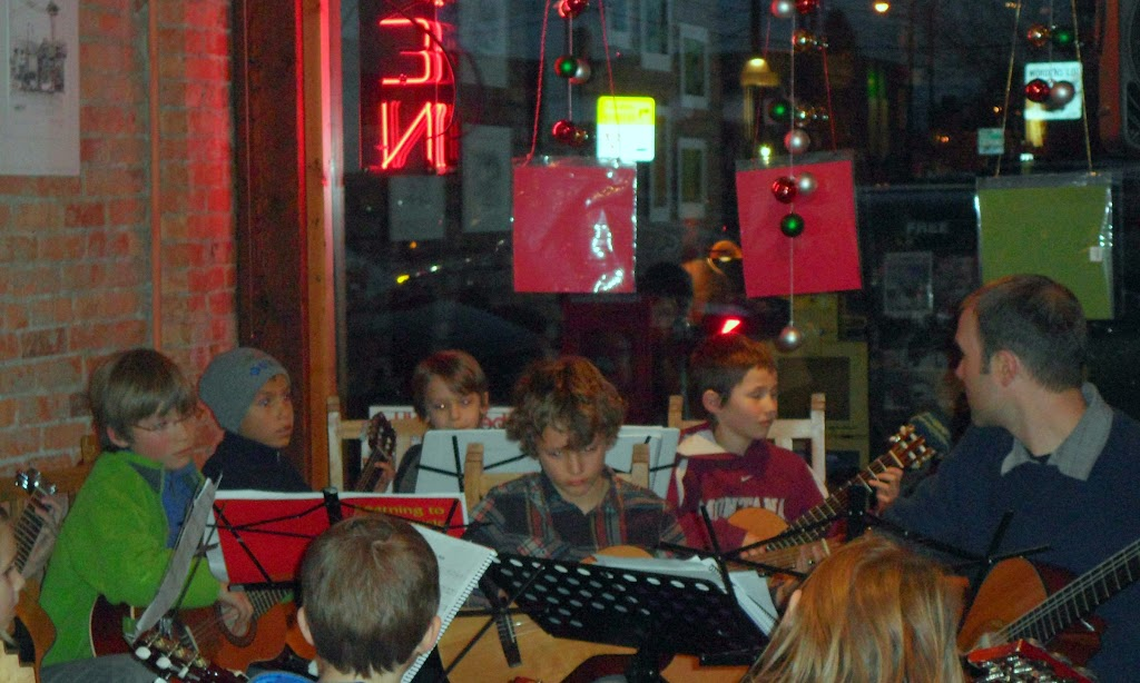 The students of the Childbloom guitar program play at Break Espresso.