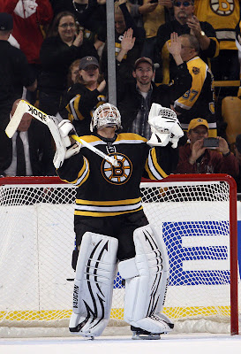 Tim Thomas celebrates the win over the Leafs