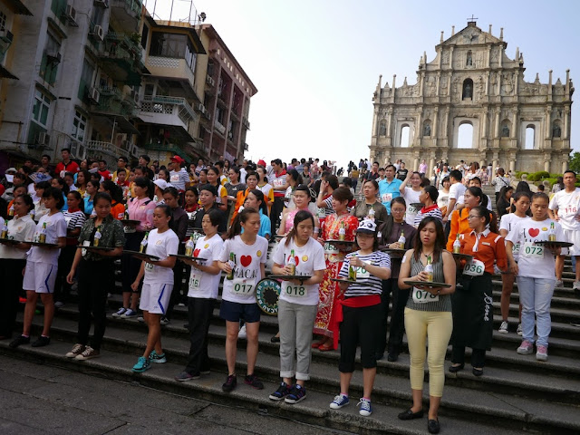 young women lined up in front of the Ruins of St. Paul for the Macau tray race
