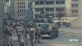 tanks and soldiers in urban setting ready to strike. seemingly historical footage