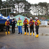 The ILB crew and catamaran's owner beside the vessel at Rockley - 24 December 2013.  Photo credit: Steve Axtell