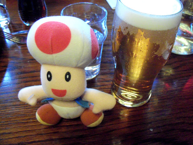 Toad with a pint of Young's