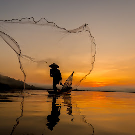 Silhouette of asian fisherman. by Visoot Uthairam - People Portraits of Men ( reflection, laos, fish, tropical, thailand, travel, burma, net, kayak, bangkok, mirror, tranquil, balance, farmer, nature, poverty, tradition, asia, province, working, water, peaceful, tonle, weed, poor, job, traditional, tourism, lake, boat, sap, myanmar, environment, le, blue, sunset, ripple, sunrise, fisherman, river )