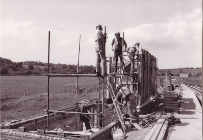 Totnes Riverside Ian Dobson, Gavin Bishop, Peter Treglown and Rodney Parker working on the erection of the Toller building.  26th May 1986.   Photo:  Les Hawkins?