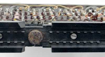 The module has 64 metal tabs that plug into the socket. The circular cam (rusted) rotates to slide the module (and the tabs) sideways into the socket.