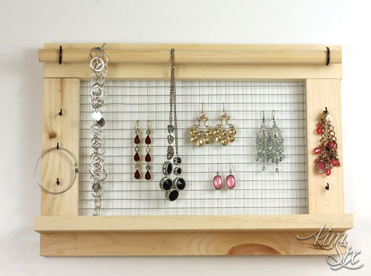 Wall Mounted DIY Jewelry Organizer from scrap lumber and chicken wire.. So fast and easy to make, plus you could personalize it however you wanted. A great way to get used to working with power tools.