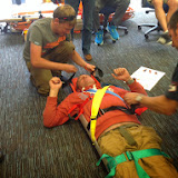 Poole crew members immobilising Helmsman Rich in the PS1 stretcher - July 2014 Photo: Dave Riley