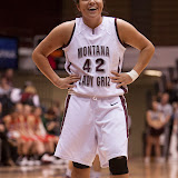 Shanae Gilham, a standout freshman for the Lady Griz, jokes at the line with one of her teammates as the clock winds down on their 85-47 victory over the Minot State Beavers.  Gilham was 5-6 from the free throw line, and added 14 points to the Lady Griz coffer.  Dahlberg Arena in Missoula, Mont., November 5th, 2012.
