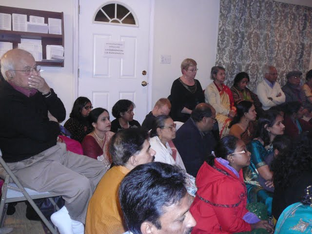 Devotees involved in the Puja