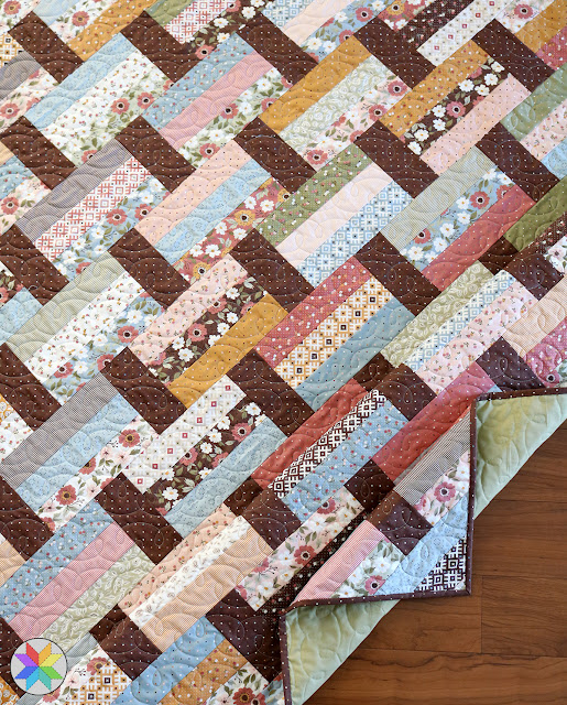 New quilt pattern from A Bright Corner called Fast Track - perfect for jelly roll strips or scraps - make a crib quilt lap quilt throw quilt or twin quilt