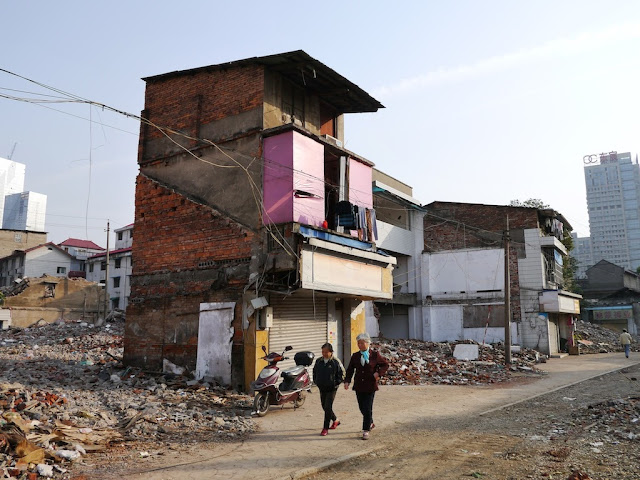 two older women walking by some remaining buildings at Beizheng Street in Changsha