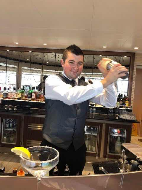 Viking Orion bartender, Boban, shakes up martini for Palmia Observatory resident astronomer