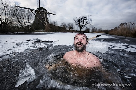 Wim Hof taking a dive in a self made ice hole somewhere in Holland.