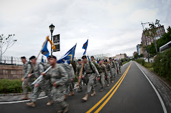 Members of the National Guard march towards the WTC Memorial on the 10th anniversary of the 9/11 attacks.