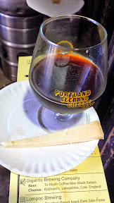 Portland Beer and Cheese Festival 2014, a pairing of beer and cheese, here Gigantic Brewing Company Too Much Coffee Man Black Saison paired with Kirkham's – Lancashire