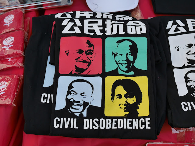 "shirt with faces of famous global activists and the words ""Civil Disobedience"""