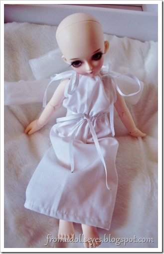 New Arrival: A Mystic Kids Doll Review: The dress is too big.