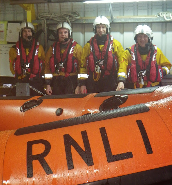 The 100th shout volunteer crew members (from left): Mark Ponchaud, Will Collins, Ed Davies and Joe Manning - 17 October 2014. Photo: Poole/RNLI