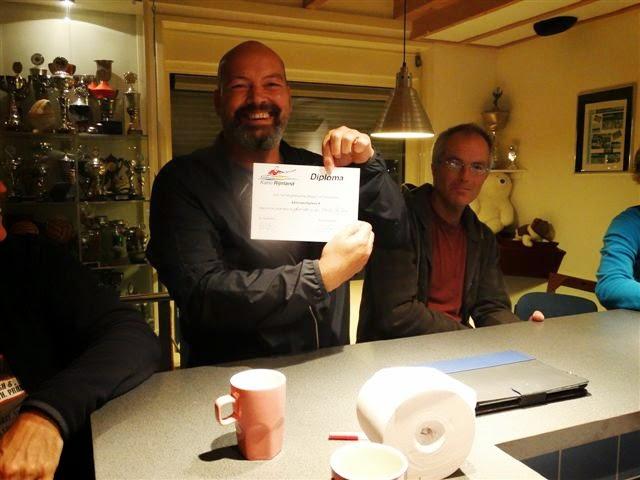 Mark blij met zijn diploma