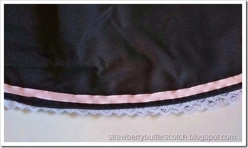After the makeover, the skirt is finished with the same lace and ribbon as the new neckline.