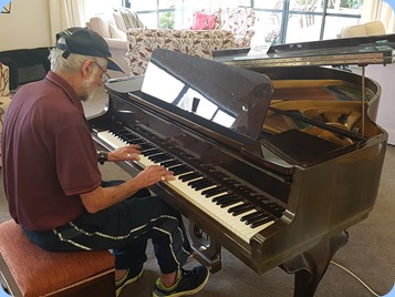 Errol Storey playing the Schimmel grand piano