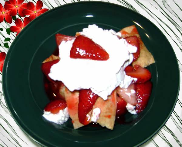Strawberries On Layered Crust Pieces With Fresh Whipped Cream.