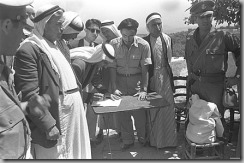 WAR OF INDEPENDENCE. MILITARY GOVERNMENT. ARAB    CHIEF OF UM EL FAHM SIGNS OATH OF ALLEGIANCE TO ISRAELI     GOVERNMENT.