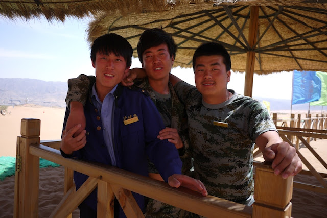 Three young men working at Shapotou in Ningxia