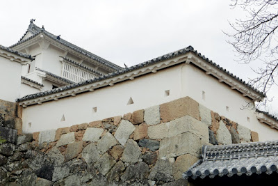 Himeji Castle, Japan. You can observe loopholes in the shape of circles, triangles, and rectangles are located throughout Himeji Castle, intended to allow defenders armed with tanegashima or archers to fire on attackers without exposing themselves. They have different heights in places based on whether you are in standing position, kneeling position, or prone position.