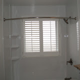 Toilet and acrylic wainscotting and vinyl shutters