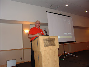 Photo: Clark Campbell of Belimo spoke about his tech session and table top display
