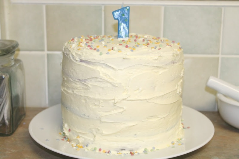 frosted-rainbow-cake-with-number-1-candle