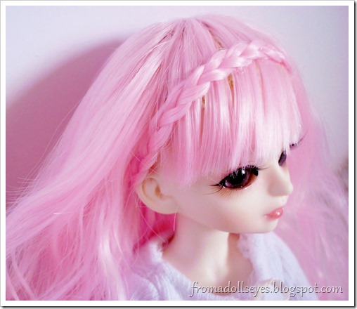 Ball jointed doll wig, restyled with a braid wrapped around like a head band.
