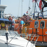A firefighter onboard a cabin cruiser that had radioed a mayday thinking it was on fire near Poole Harbour entrance. Poole ALB had towed it in to Poole Quay Boat Haven to be checked over - 10 August 2013 Photo: Lily Clark