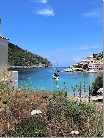 View of harbour with boat, Assos, Kefalonia, Greece photo by Sue Wellington