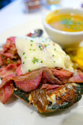 Higgins Portland Lunch and Bistro menu option of the Open-faced sandwich of pastrami, grilled onions & sharp white cheddar