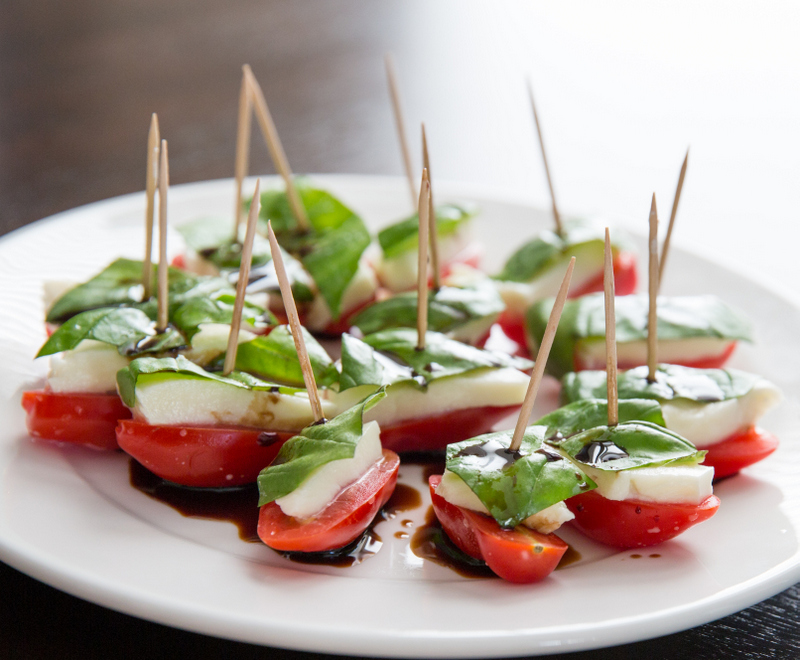 photo of a plate of caprese salad appetizers
