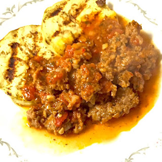 Italian Sausage Tomato Sauce on Grilled Eggplant