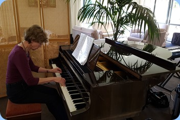 Denise Gunson playing the Schimmel mini-grand piano.
