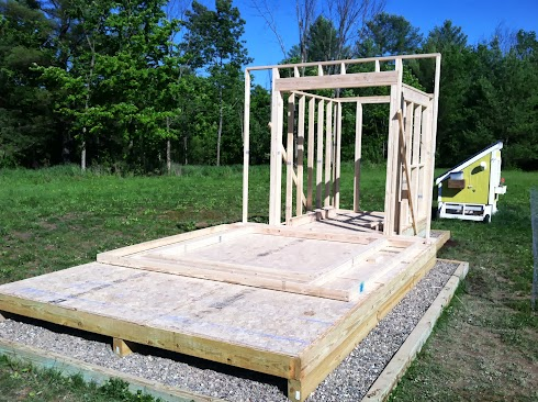 Shed deck with coop walls framed