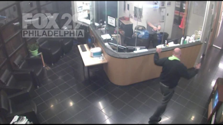 Armed security officers at FOX 29 confront armed man breaking into lobby