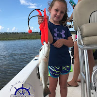 Lily with a small Redfish 06-27-2018