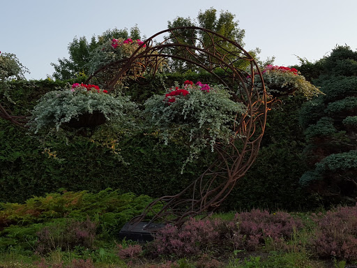Art as plant holder. More than A Garden: Curious Llamas, Tiny Houses, and Teapot Trees at Kingsbrae Garden
