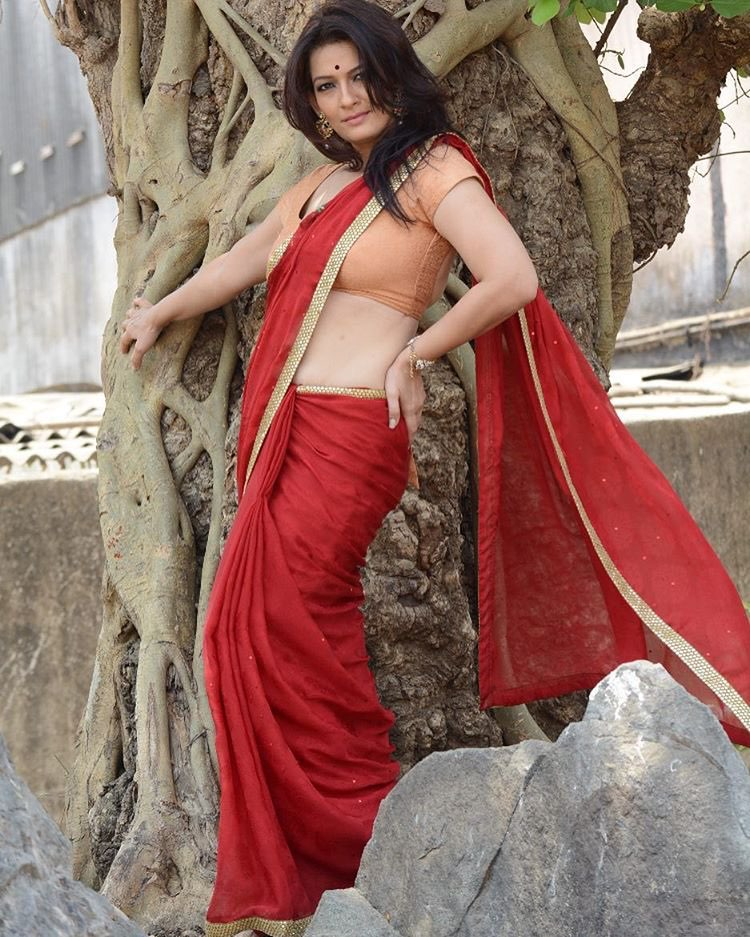 Falguni Rajani hot latest transparent saree sleeveless blouse navel show Navel Queens
