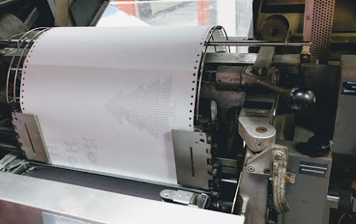 Printing a greeting card on the IBM 1403 line printer.