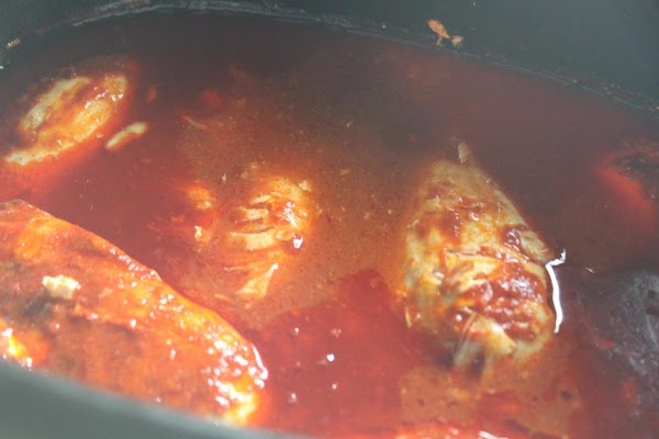 Take chicken and place it in a slow cooker with hot sauce and half...