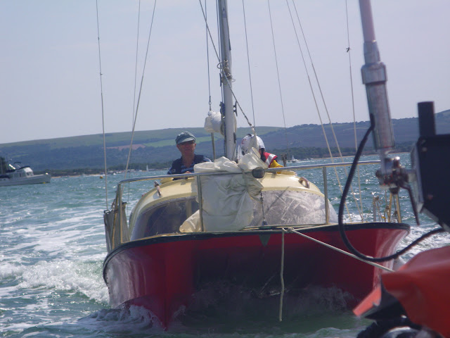 3 August 2011 - Poole inshore lifeboat towing a 6.5m catamaran to Stakes Buoy in Poole Harbour (Photo: RNLI/Poole Lifeboat Station)